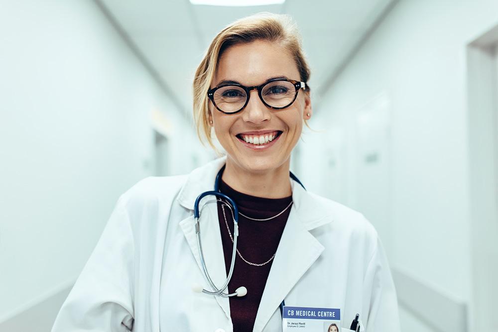 female medical doctor in white coat