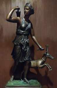 Bronze statue of a woman and dog